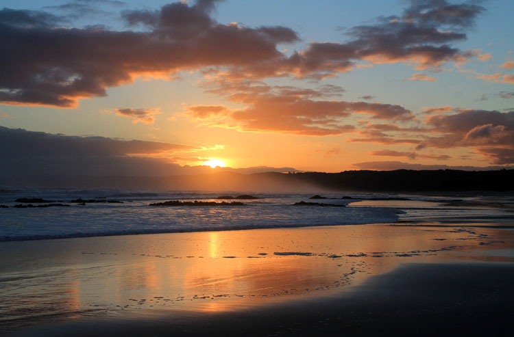 Brighton Beach, one of the best places to watch the sunset in Dunedin, New Zealand