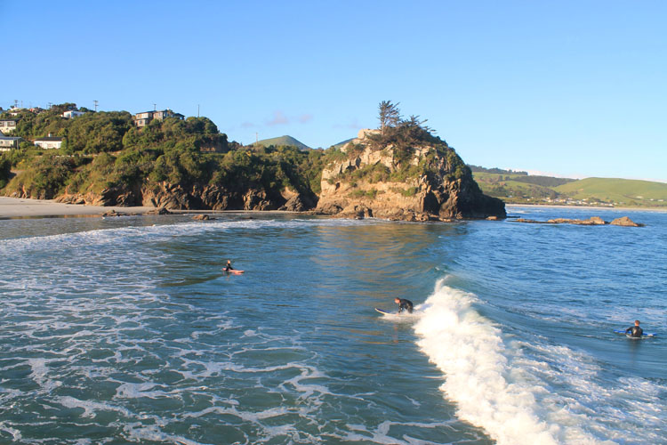 Surfing at Brighton Beach, Dunedin, New Zealand