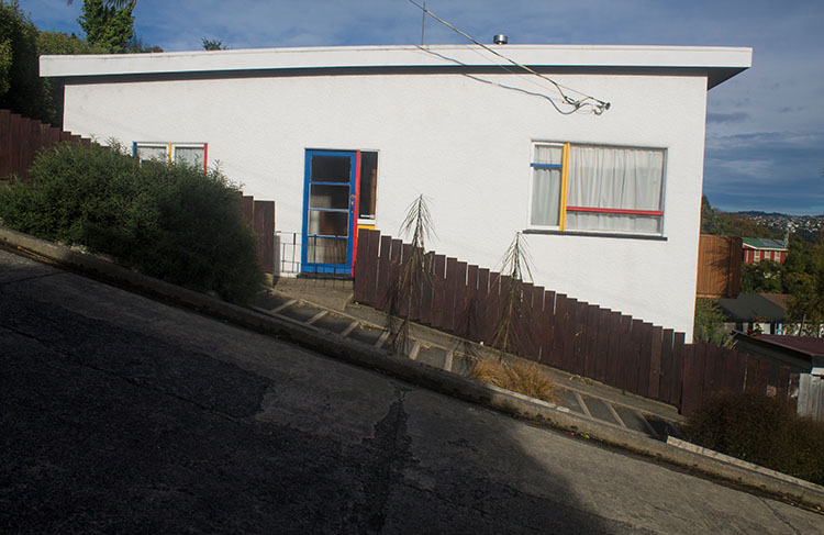 A house on Baldwin Street, Dunedin, New Zealand -- the steepest street in the world