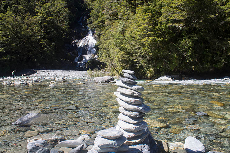 A cairn at Fantail Falls, Wanaka to Haast road, New Zealand