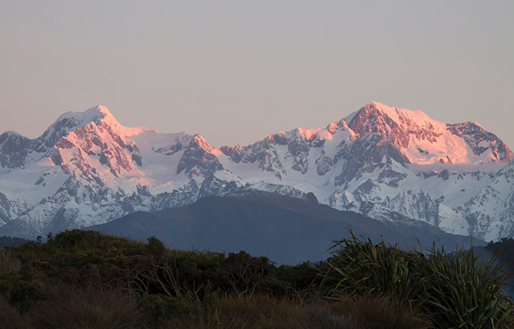Sunset mountains at Gillespies Beach, West Coast, New Zealand