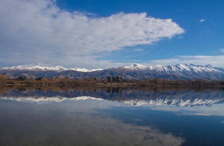 Mountain reflections at Lake Opuha, Fairlie, New Zealand