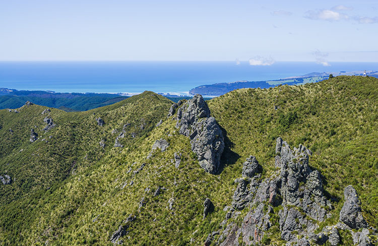 Rocky hills in the Silver Peaks Scenic Reserve, Dunedin, New Zealand